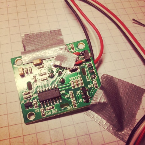 Sensor board and jumper duct-taped in place for soldering, almost done.